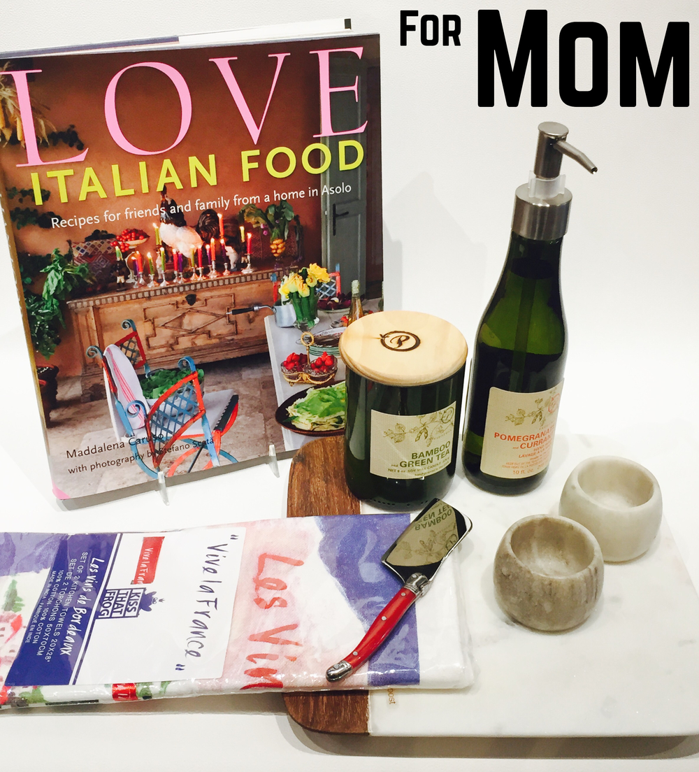 Moms are always the hardest to gift for but upgrading their entertainment essentials will inspire them to keep the party going in the new year! Italian cook book, pair of kitchen towels, Laguiole cheese knife, marble salt and pepper cellars, marble cheeseboard, wine bottle candle and hand soap.