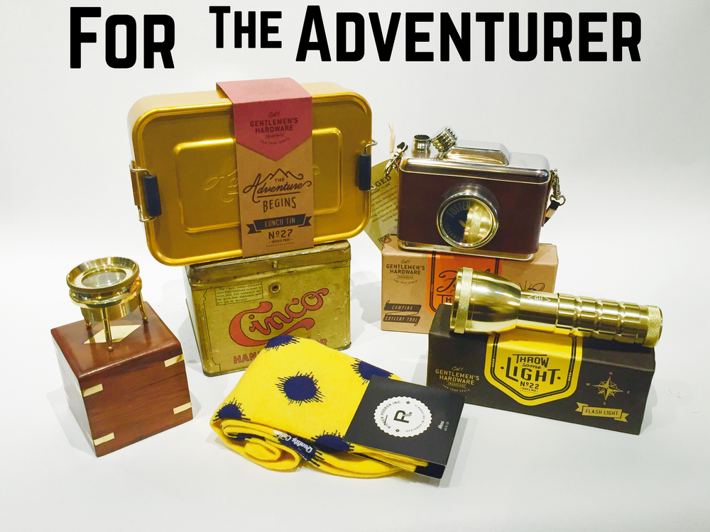 What a great package for that friend/brother/dad who is always on the go and off to seek the next thrill!  Adventure lunch tin, 3 legged magnifier, cools socks, gold flash light, secret camera flask.