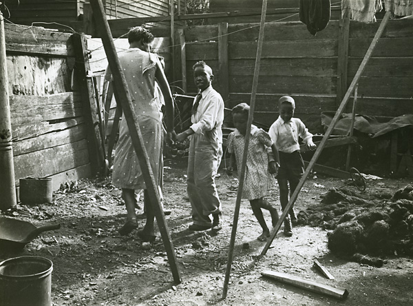 New Orleans: A Backyard, 1938. Vintage gelatin silver print, 1938. Image measures 7 X 9 1/2 inches. Inventory no. PS0014. Terms  |  Inquire