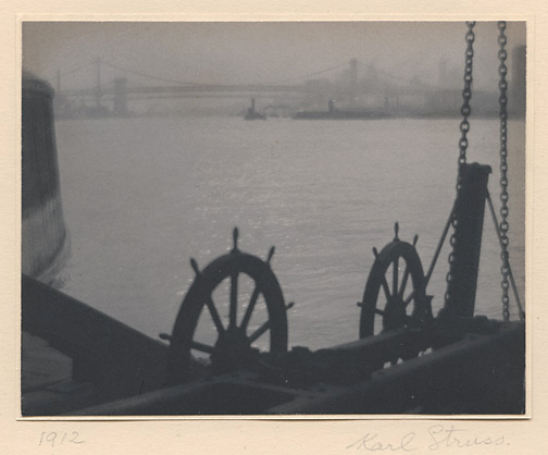 East River,     1912. Vintage platinum print. Signed and dated in pencil on mount. Struss's Hollywood credit stamp and Pictorial Photographers of America label on mount verso. Image measures 3 5/8 x 4 5/8 inches. Inventory #C0466.