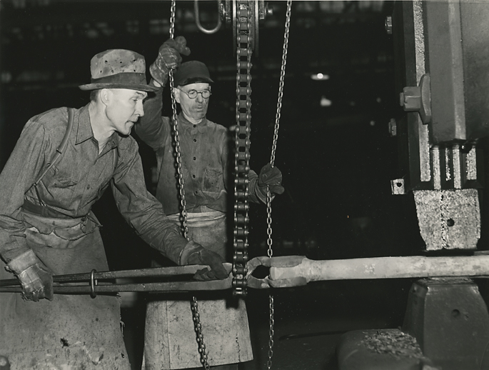 Using 2000 lb. steam hammer on Jar rein for drilling equipment. Keystone Drilling Co. Beaver Fall Pa., 1941. Vintage gelatin silver print. Vachon's Farm Security Administration credit stamp on back. Image measures 7 3/16 x 9 1/2 inches. Inventory #C1183 Terms  |  Inquire