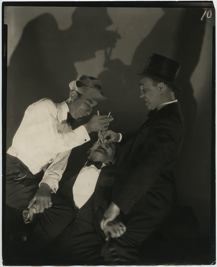 """Clayton. Jackson & Durante, 1928. Gelatin silver print, printed no later than 1951. Inscribe by Steichen on print verso: """"Unpublished."""" Publication stamps and inscriptiosn from Collier's Magazine. July, 1951. Originally shot for a Vanity Fair story in 1928, this unused image was reproduced in Collier's for a 1951 article on comedian Jimmy Durante's vaudeville career. Image measures 9 1/2 x 7 5/8 inches. Inventory #C1567. Terms