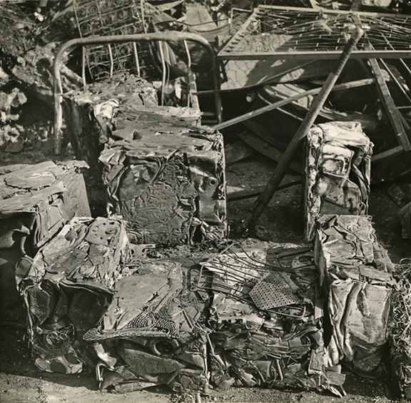 Scrap metal, Harlem, New York   ,   ca. 1941. Vintage Gelatin Silver Print, printed ca. 1941. Image measures 7 5/8 x 7 7/8 inches. 'PM    Photograph by Morris Engel' stamp on print back. Captioned in ink on back and  PM   file stamp dated Mar 26 1941. Inventory #C0694.  Terms    |    Inquire