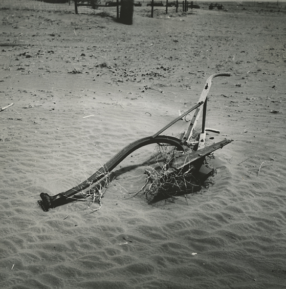 Plow almost buried by sand. Cimarron Country, Oklahoma  , 1936. Vintage gelatin silver print. Rothstein's Resettlement Administration credit stamp  with negative number and title in pencil on print verso. Image measures 7 13/16 x 7 3/4 inches. Inventory #C0647  Terms    |    Inquire