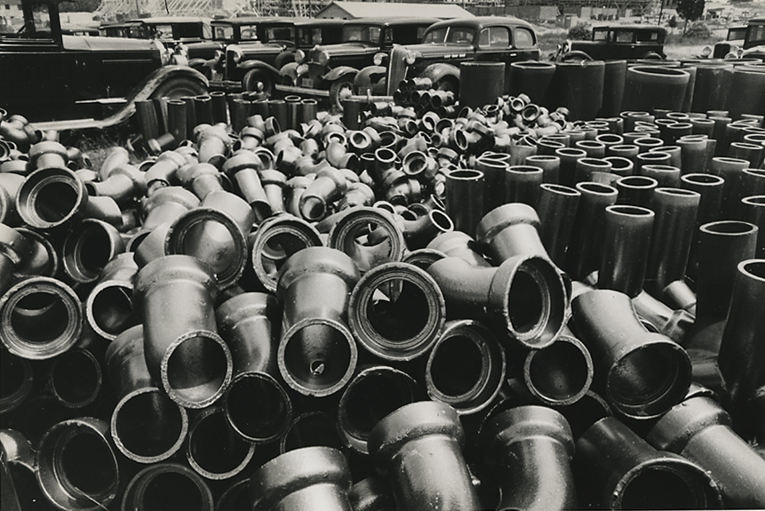 Sewer Pipe Storage, Greenbelt MD ,       1936. Vintage gelatin silver print. Signed in ink. Mydan's Farm Security Administration credit stamp with negative number in pencil on print verso. Image measures 6 3/8 X 9 5/8 inches. Inventory #MC0034.  Terms    |    Inquire