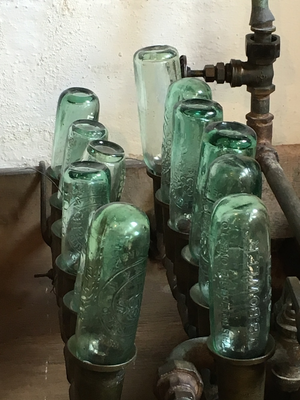 A line-up of bottles from the same soda factory.