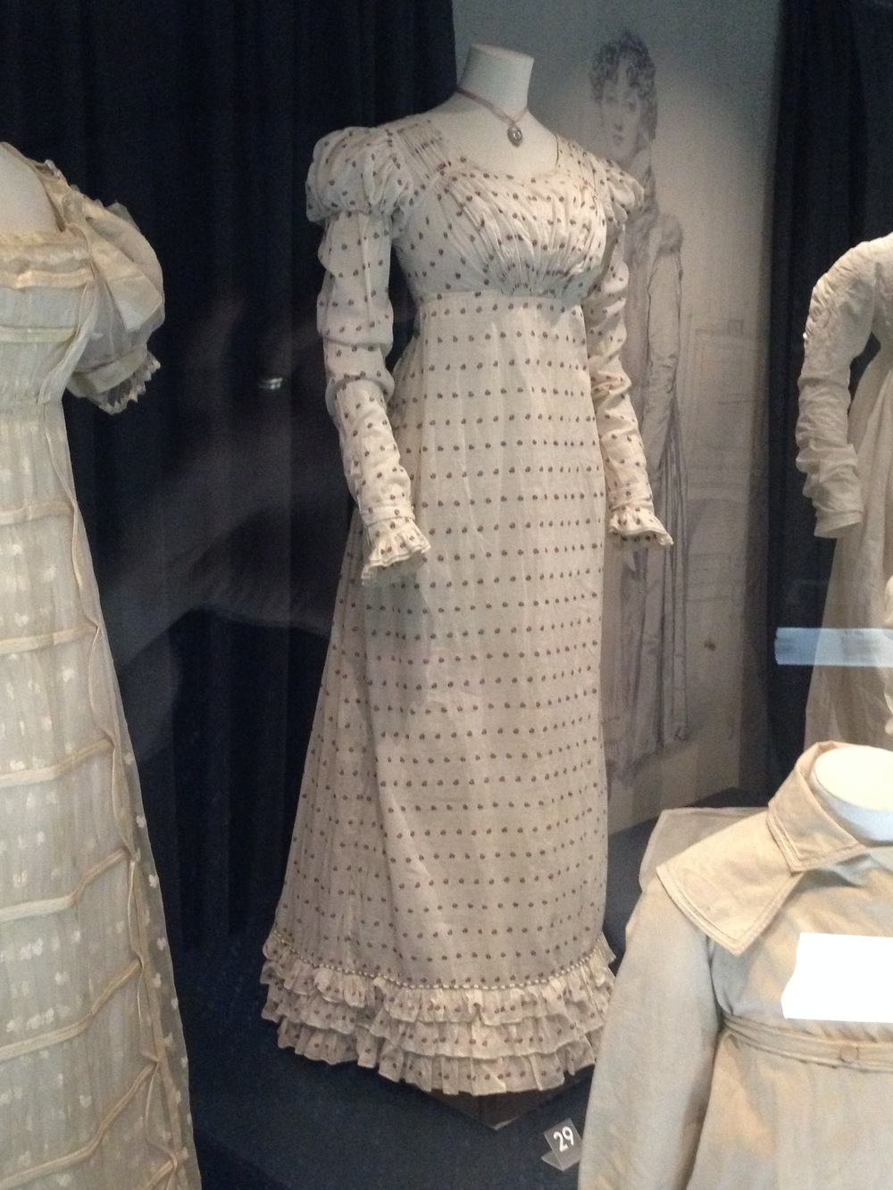 They had quite a few Regency-era dresses. Here is a plainer Regency day dress, made out of printed fabric.