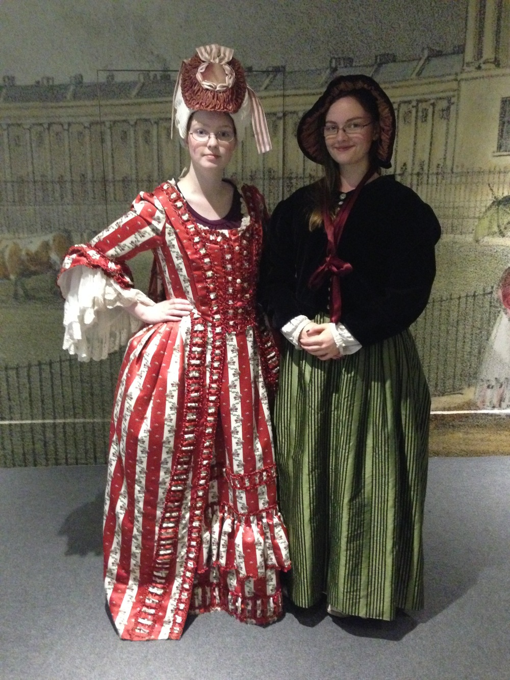 Me (left) in the 18th-century costume and wig, my sister (right) in a 19th-century dress and bonnet.