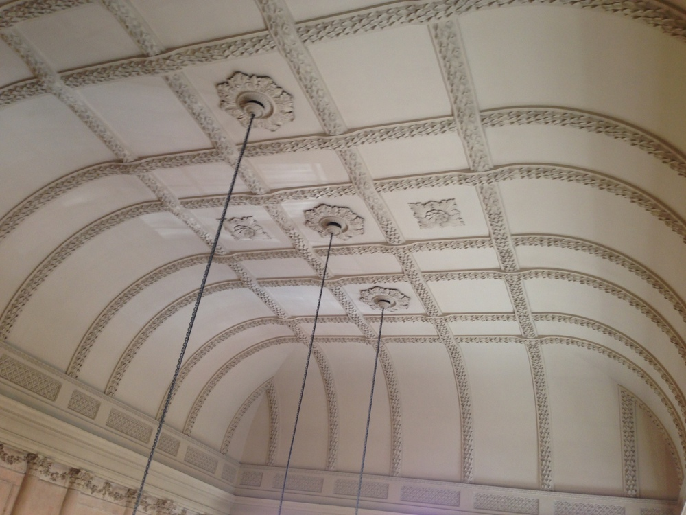 A nice shot of all of the intricate molding and details of the ceiling of one of the rooms.