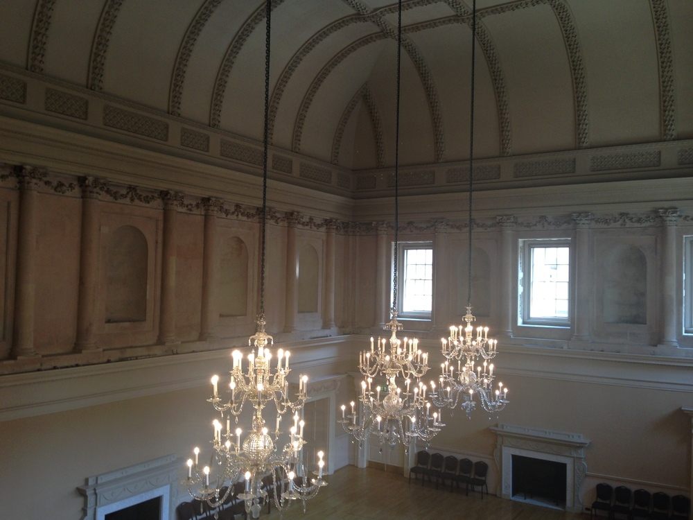 A nice shot of the windows, the stone, the ceiling details, and the chandeliers.