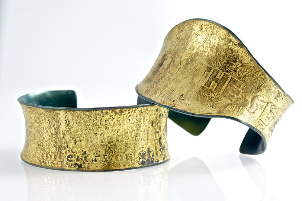 Iron and gold cuffs by Kim Nogueira