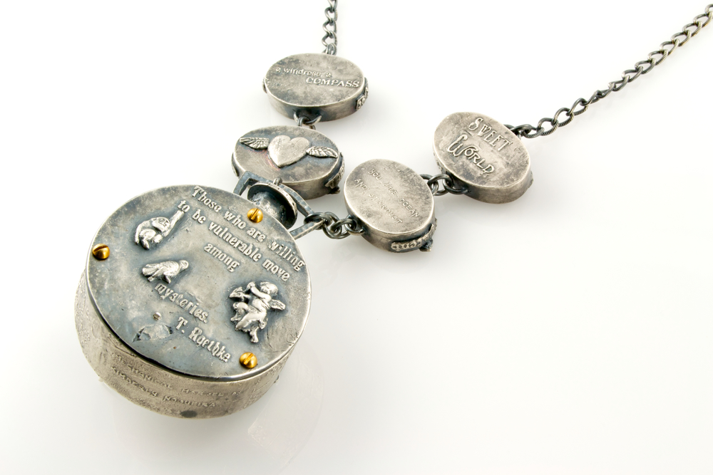 """I search for a memory so ancient"" automaton pendant by Kim Nogueira"