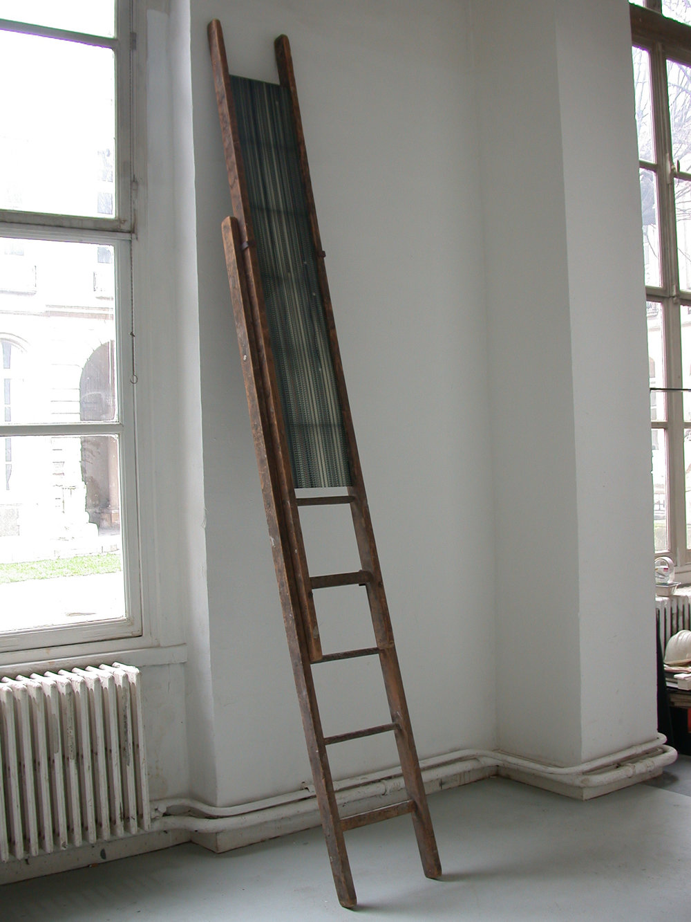 Echelle by Etienne de Fleurieu , collage de pellicule cinématographique 16 mm sur polychoc blanc , échelle en bois