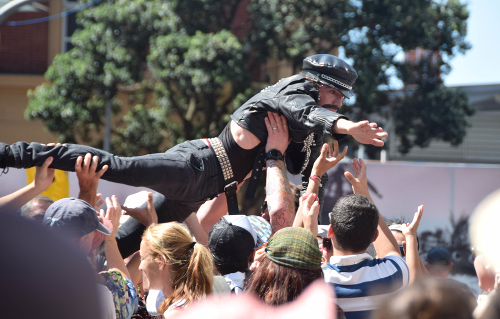 Mario crowdsurfing after his performance