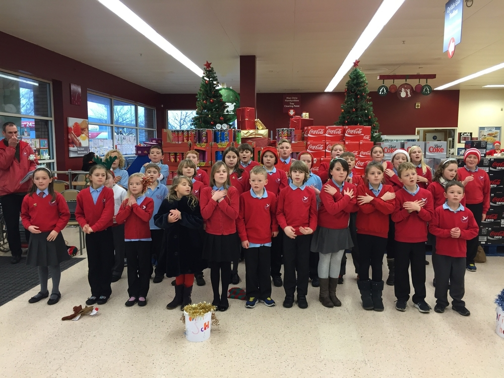 Children from Class 2 entertain the shoppers in Tesco