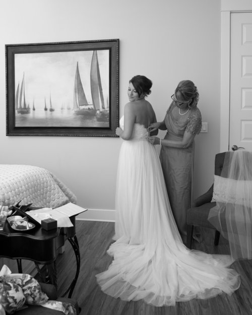 BRIDE AND GROOM IN THE WATER FOR A DESTIN FLORIDA BEACH WEDDING PACKAGE