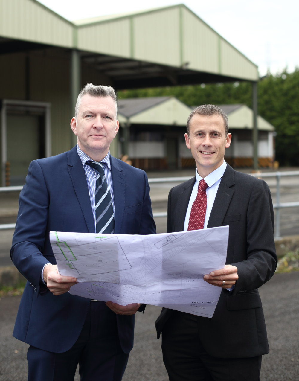 Pictured at the site of the former Coke plant in Lisburn is Mark Robinson, Group Commercial Director and Roger Pannell, Managing Director of Unicorn Group who have purchased the site in a multi-million pound deal.