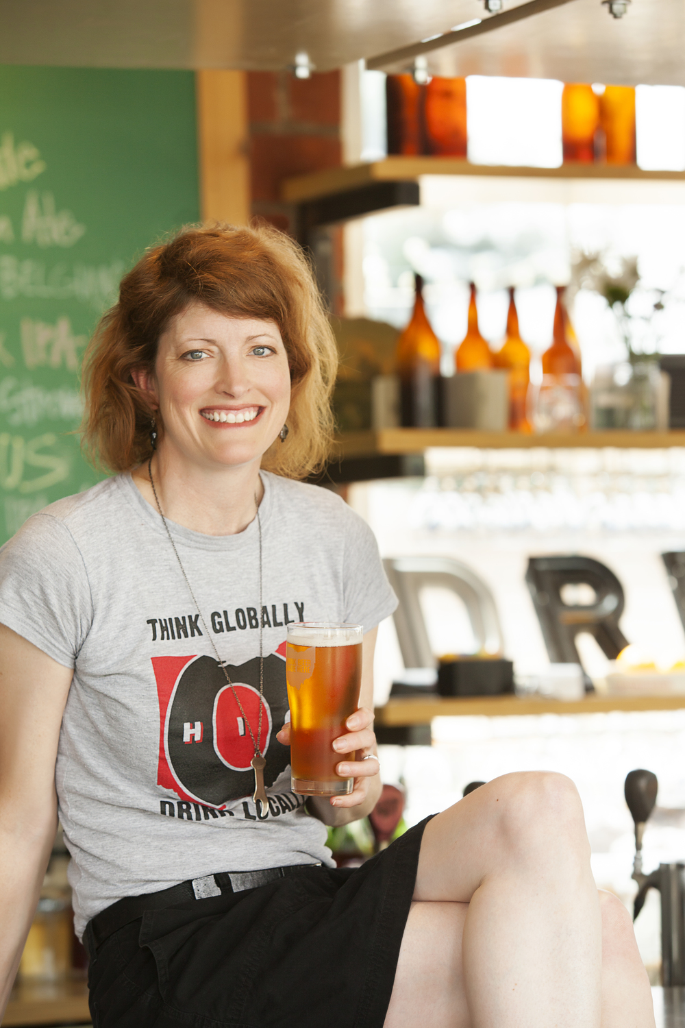 Ohio Craft Brewers Association's executive director, Mary MacDonald, enjoying a local beer at Seventh Son Brewing Co. Photo by Catherine Murray