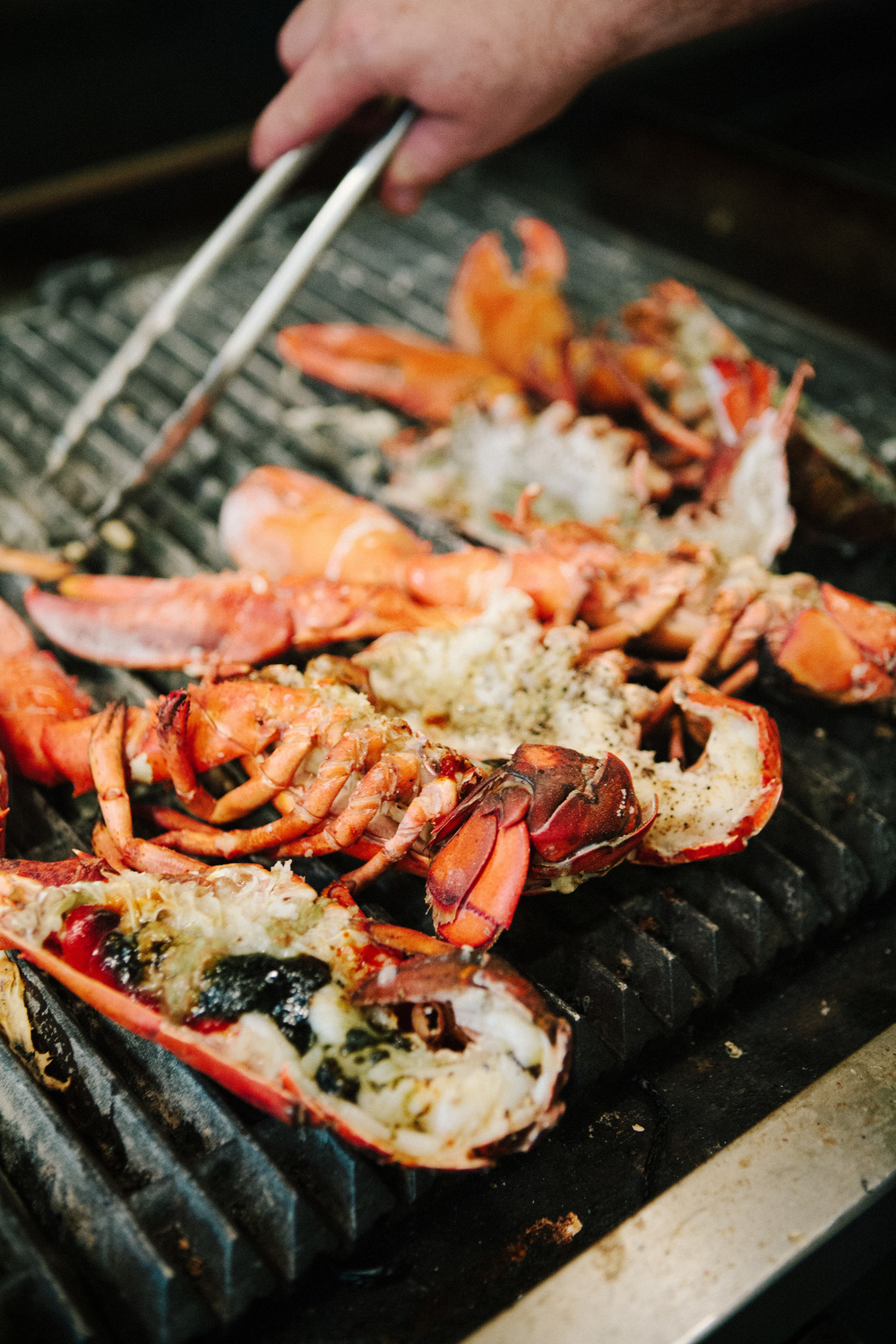 The lobster is fire-grilled and served with sweet pea pancakes, clarified butter and lemon.
