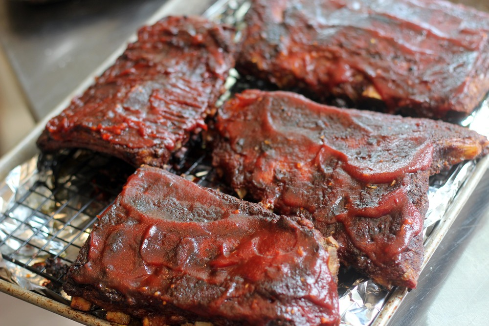 Oink Moo Cluck ribs with homemade barbecue sauce. We won't judge you for that sauce all over your face.