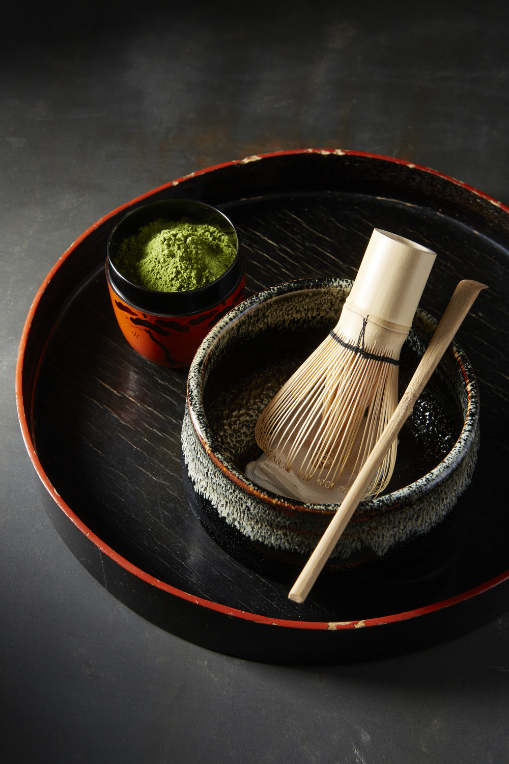 The traditional presentation for the Japanese tea ceremony, sadō, the way of tea. The bamboo whisk whips the matcha green tea powder into a fine foam and the minature mountain of matcha is symbolic of the tea ceremony's Buddhist origins.