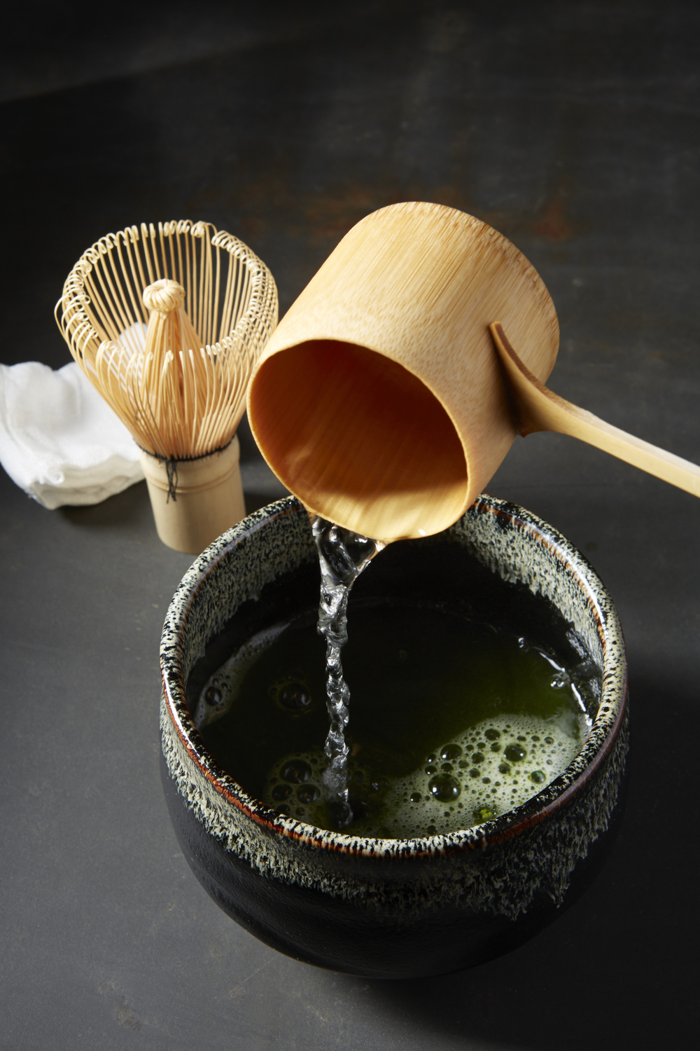 """During the Japanese tea ceremony, the host uses hishaku—a bamboo water ladle—to measure the amount of hot water from the tea kettle."""