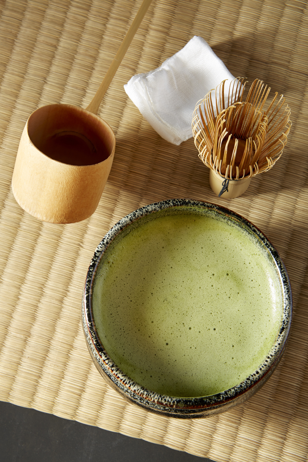 """The host also chooses a beautiful ceramic from which matcha is drunk. In winter a deeper bowl keeps the heat longer. In harmonious hand movements, the host whisks the tea with hot water, placing the bowl next to the guest. The guest drinks the tea, then admires the bowl."""