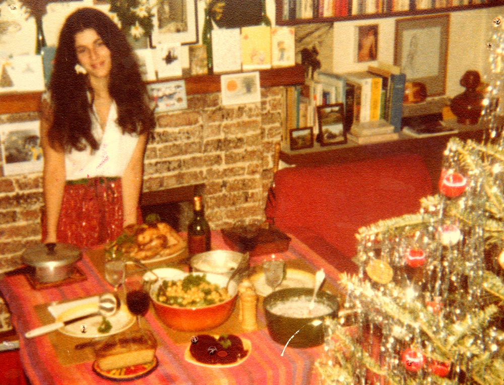 Michelle Herman beside a tableful of food she cooked on Christmas in 1980.