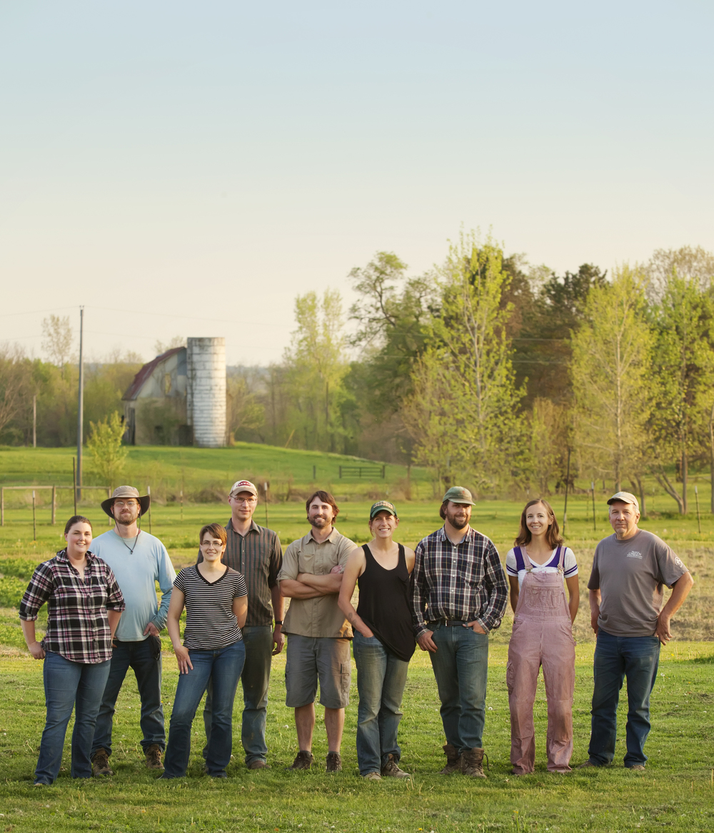 The farmers of the farmer-owned cooperative, Great River Organics, from left to right: Lisa and Ben Sippel of Sippel Family Farm; Todd and Heather Schriver of Rock Dove Farm; Ben Dilbone of Sunbeam Family Farm; Adam Welly of Wayward Seed Farm; Kristy Buskirk of Clay Hill Farm; Becky Barnes of Dangling Carrot Farm; and Tim Patrick of Toad Hill Farm.