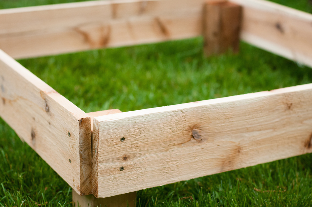 A fully constructed cedar compost frame
