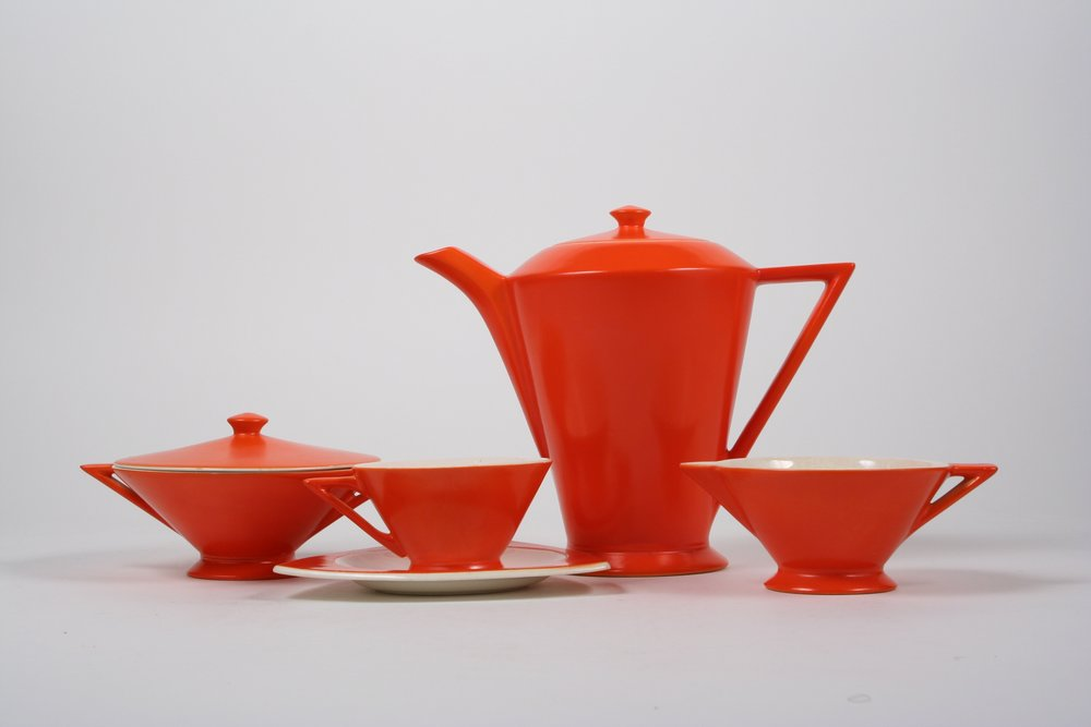 Designed by Don Schreckengost (Ohio designer) and others and manufactured in Ohio (Salem China) in the 1930s.