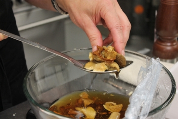 Dried mushrooms are reconstituted in hot water, creating a flavorful broth in the process.