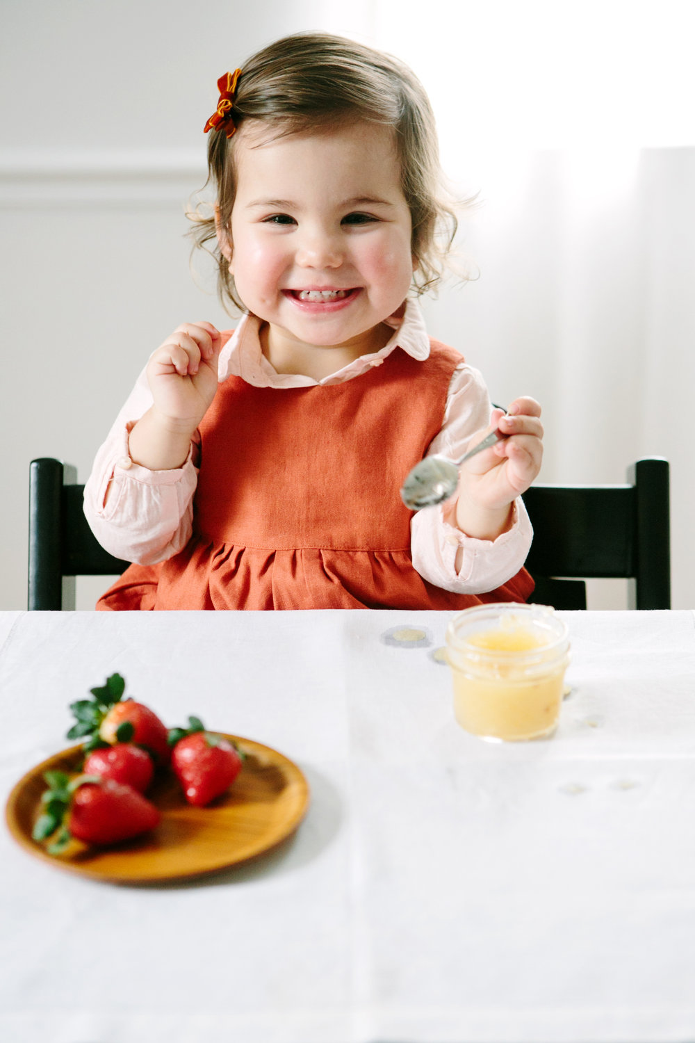 Bianca, just over 1½years old,enjoys her applesauce and strawberries.