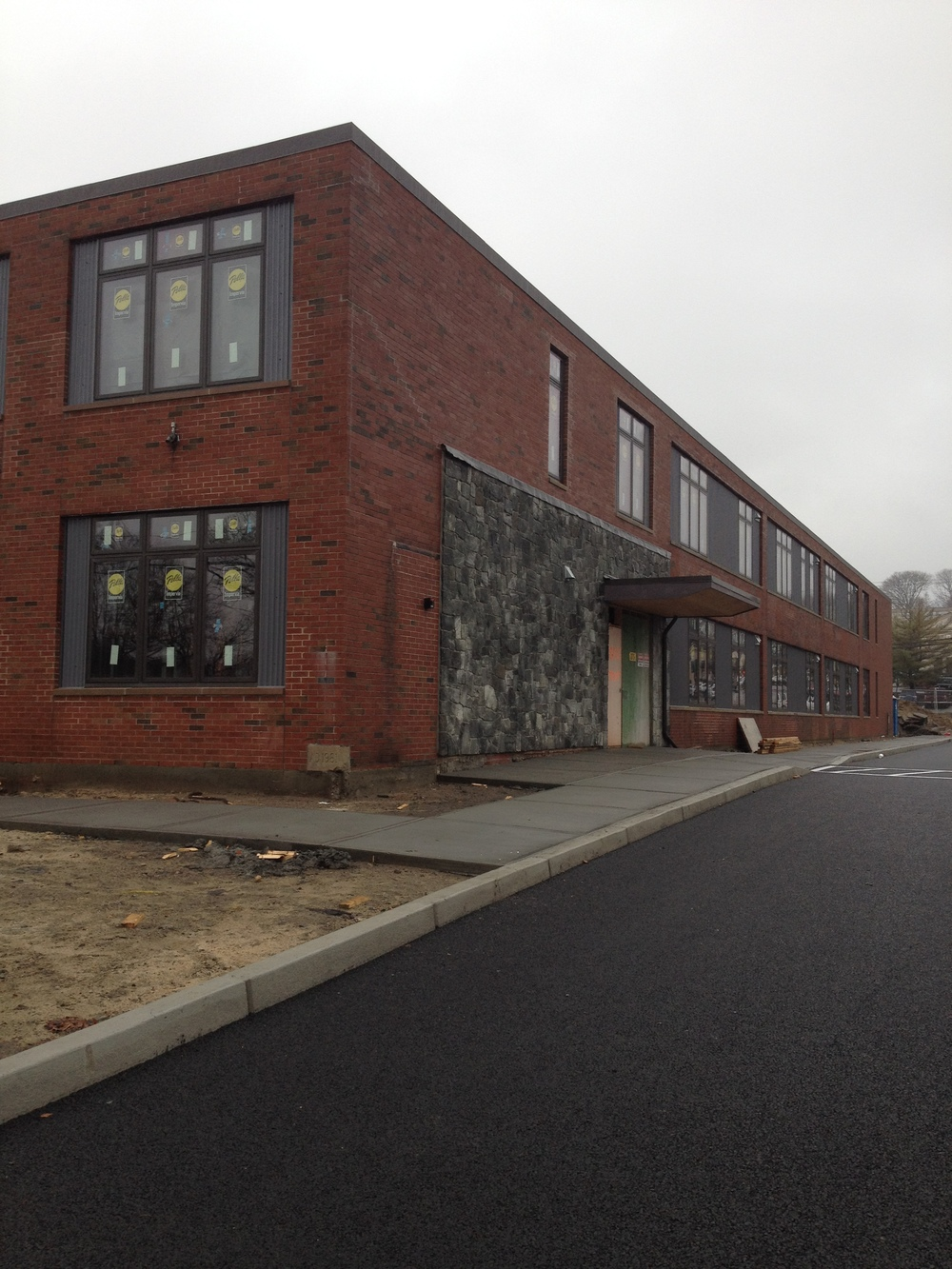 New awning and stonework at front entrance (and permeable asphalt in the parking lot!).