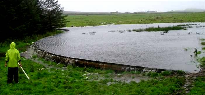 "With heavy rains, the ""bunds"" slow the flow of water, allowing it to soak into the ground."