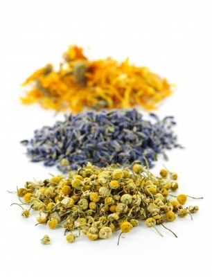 7776400-piles-of-dried-medicinal-herbs-camomile-lavender-calendula-on-white-background.jpg