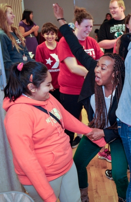 Dancing to the tune of her own beat, Briana celebrates with a Streetworkz student during a Thursday night dance party.