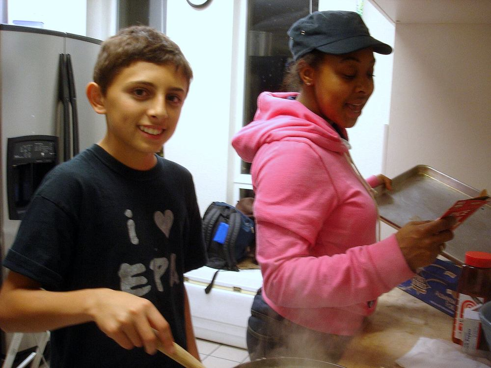 EPA Fellow Briana, works with a youth to prepare the StreetWorkz fellowship meal.