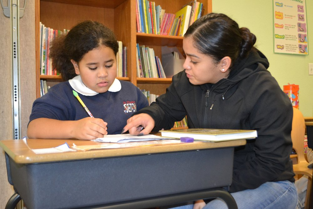 Homework Help - Lorena assists a student with her homework.