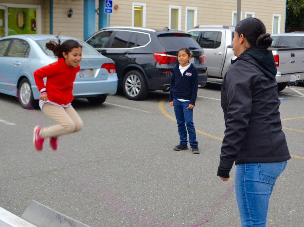 Recess - Lorena and her students play jump rope during recess.