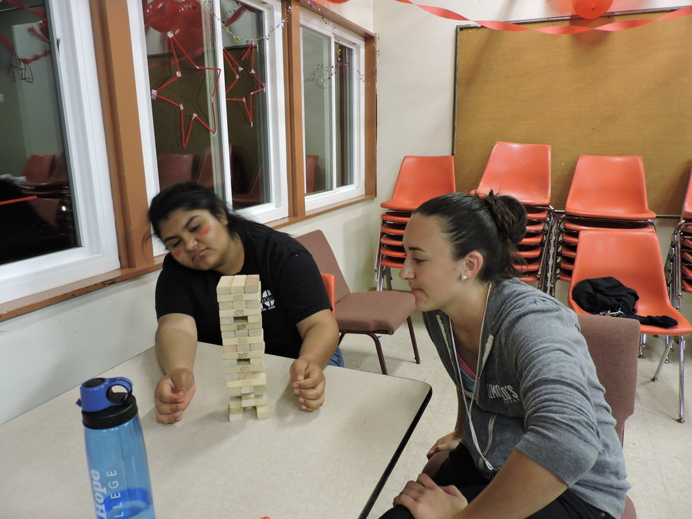 Game Time! - Jordan playing an intense game of Jenga with one of her students.