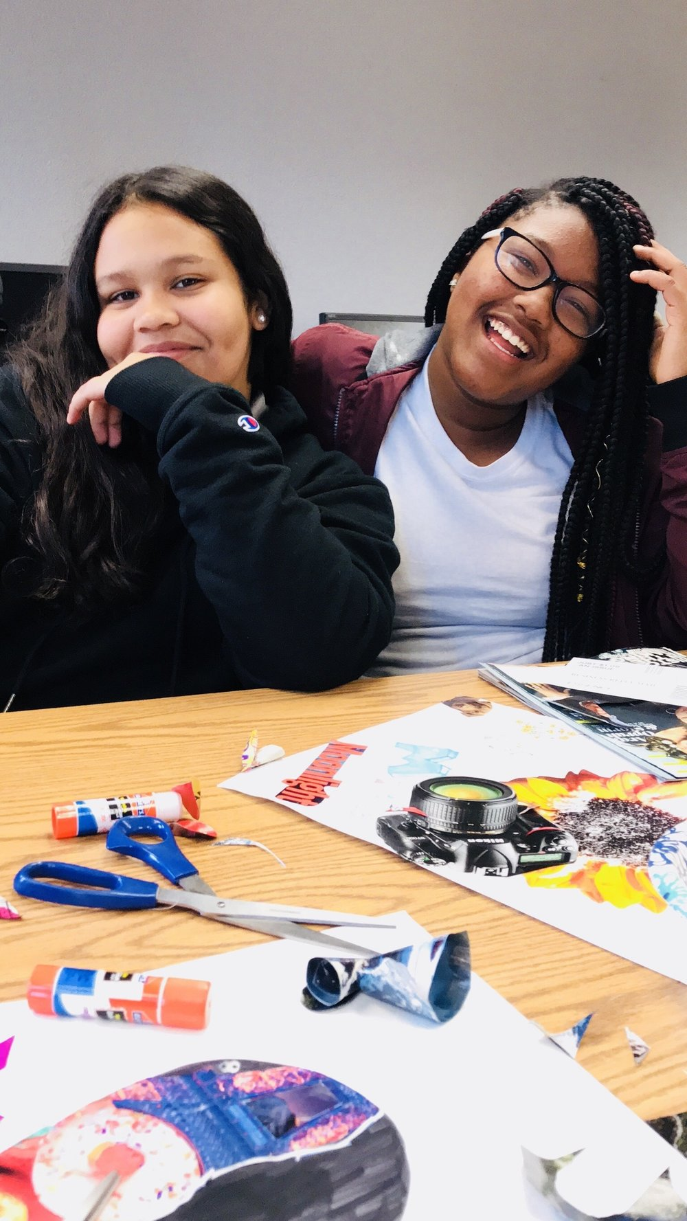 Say Cheese! - Students take a moment to smile for a picture as they work on their projects.