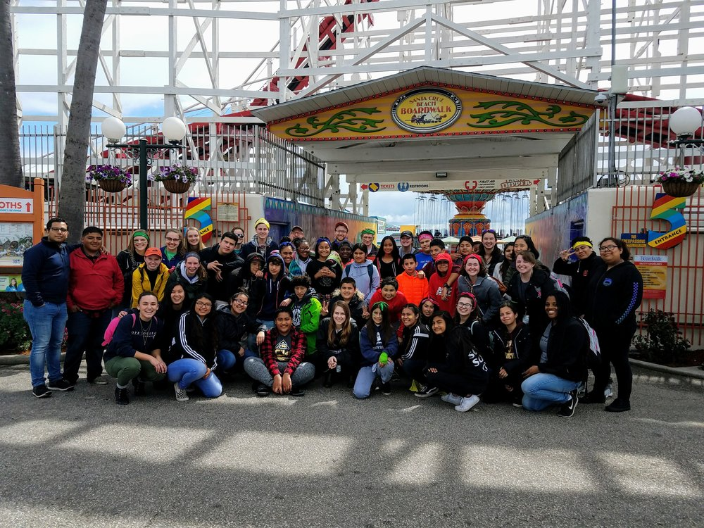 Santa Cruz - Students, volunteers and staff pose for a picture at Santa Cruz Beach Boardwalk.