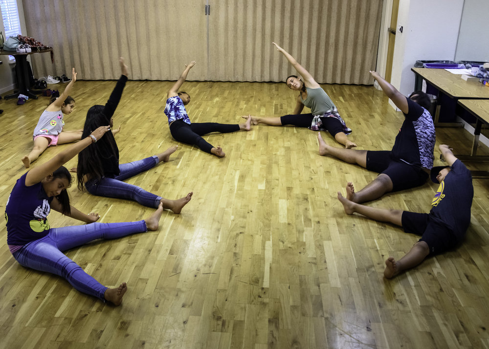 Dance - Students stretch during CREATE Academy's dance class last summer.