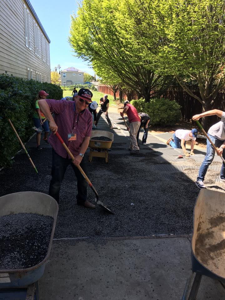 Hard At Work! - Art helps lay gravel behind the BCM building.