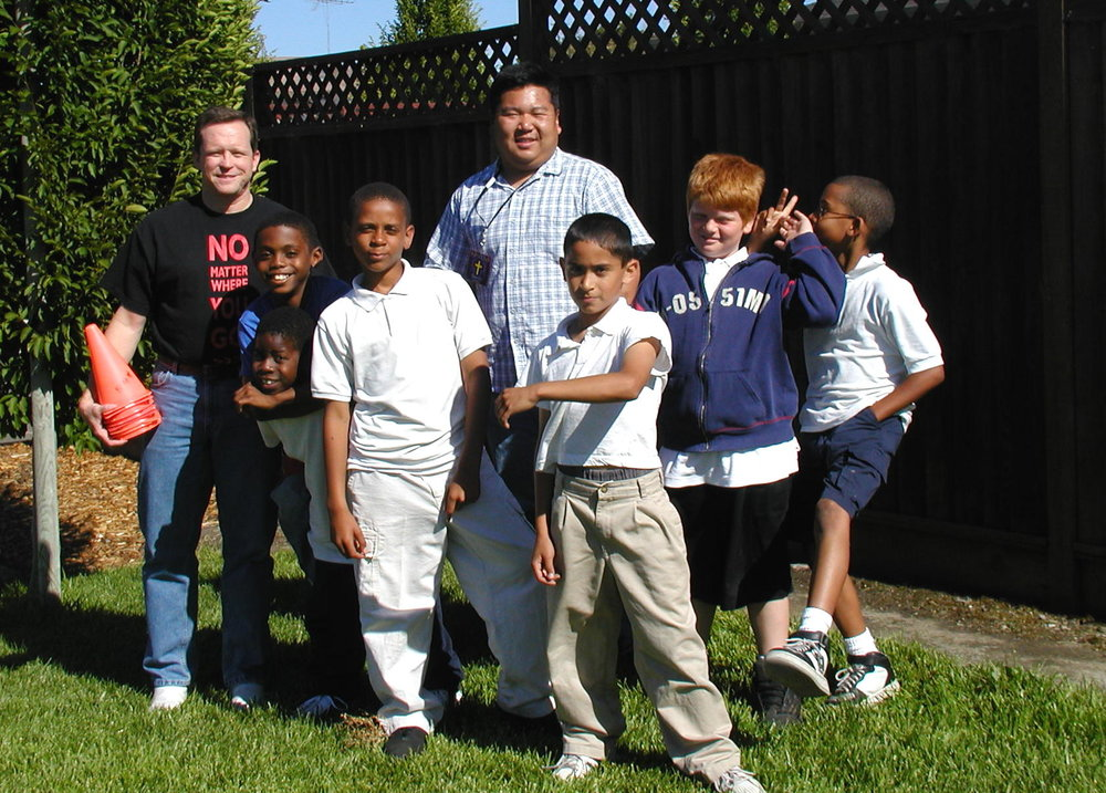 """Boys Club - Here Andrew and another staff member poses with the """"Boys Club"""". (Picture taken in 2004)"""