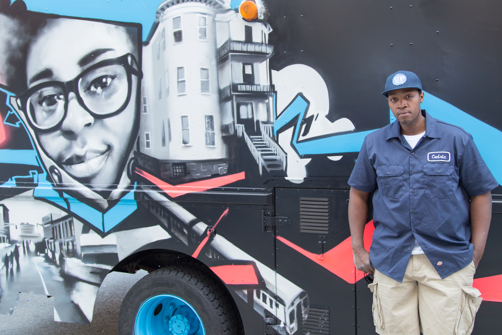 Cedric Douglass in front of the UpTruck  Photo by:  Travis Watson