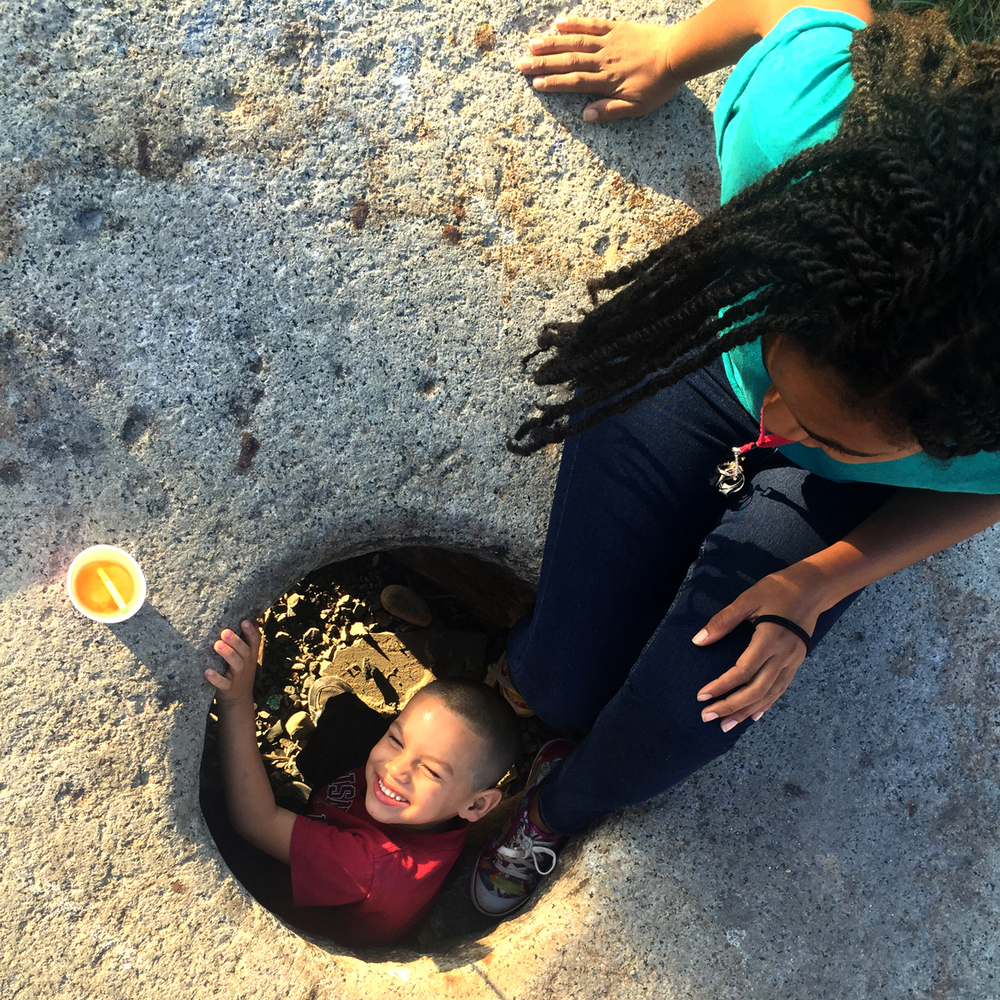J and Azia explore the millstone at The Cornerstone