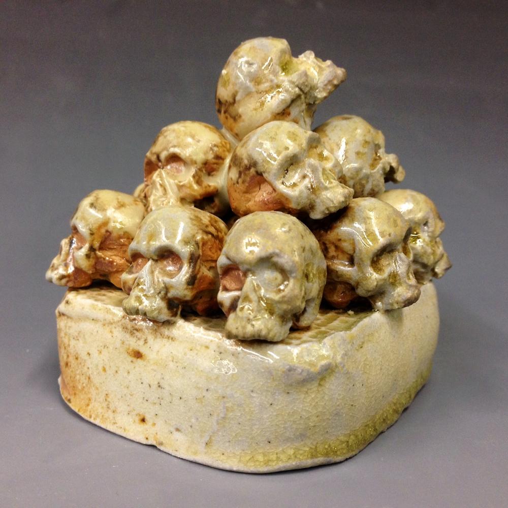 """""""Skulls"""" 5""""x5"""" Wood Fire Stoneware $45 SOLD"""
