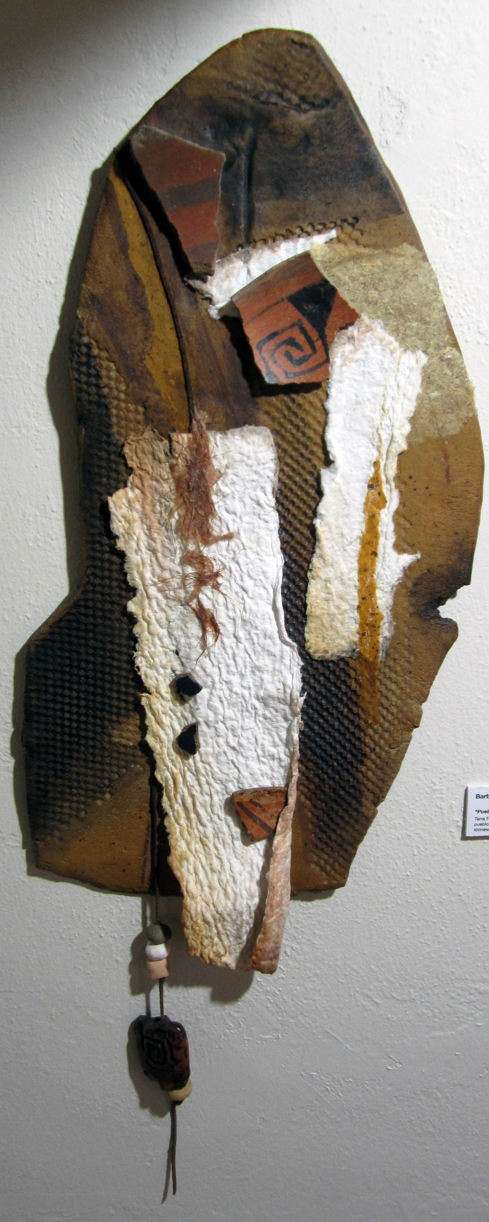"""""""Pueblo Pieces"""" Terraform $300  Consists of handmade paper, clay beads, early Pueblo shards (found on private land, rice papaer adn watercolors, and is attached to stoneware clay. The piece has been sealed with UV Protective spray. SOLD"""
